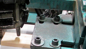 Nailing moulding and door stop to jamb with automated equipment